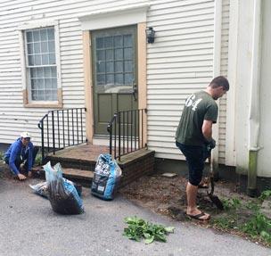 Volunteers cleaning up garden around Parish House