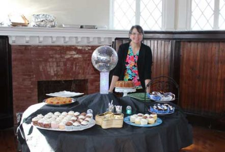 Marie with her homemade 1970's themed desserts