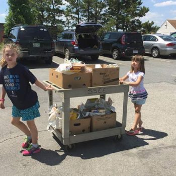 Kids from First Parish Plymouth with foodbank