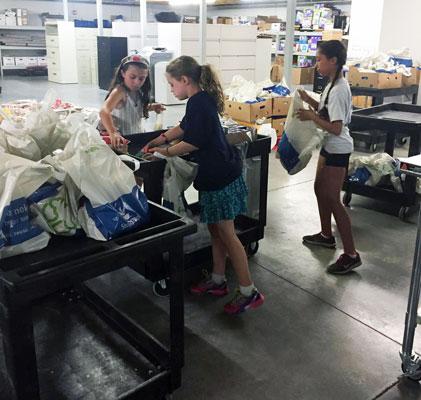 First Parish children sort food at foodbank