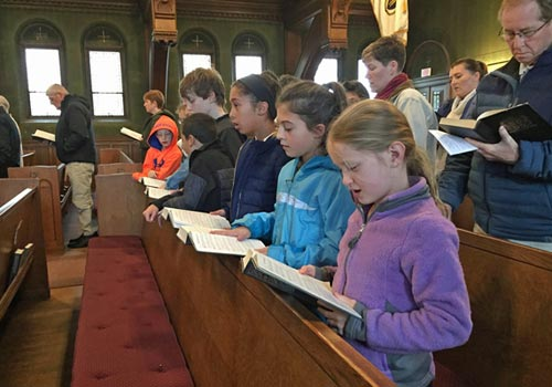 Kids singing during Sunday service